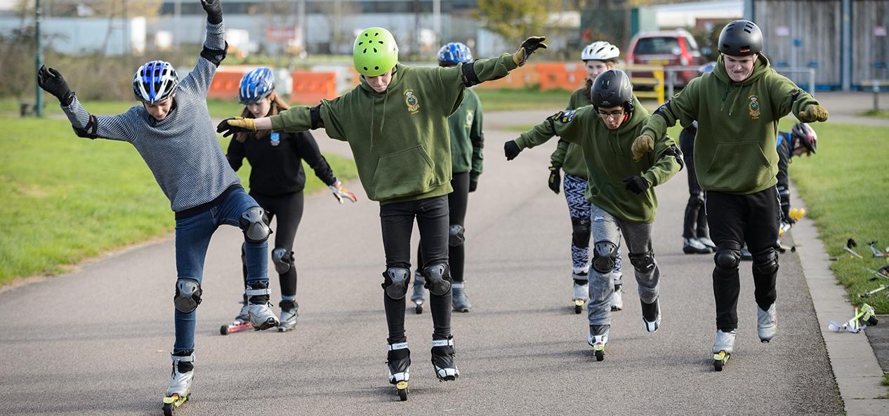 Teenagers try Nordic skiing on roller skis