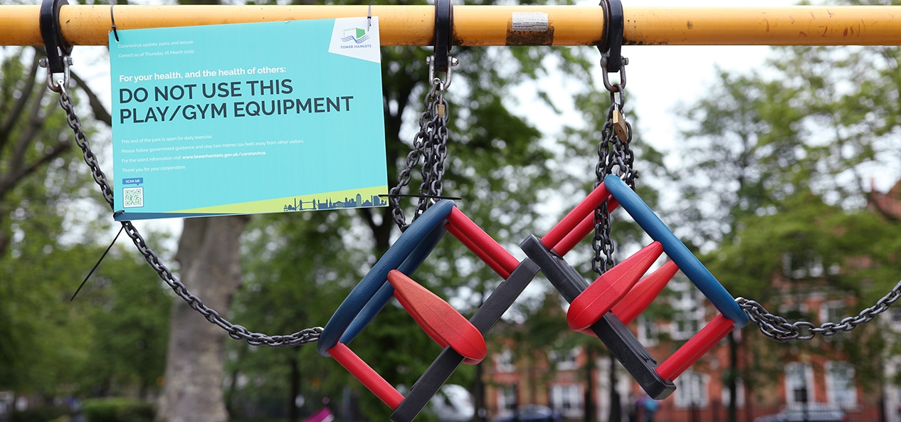 A sign on a children's swing saying do not use, due to coronavirus restrictions