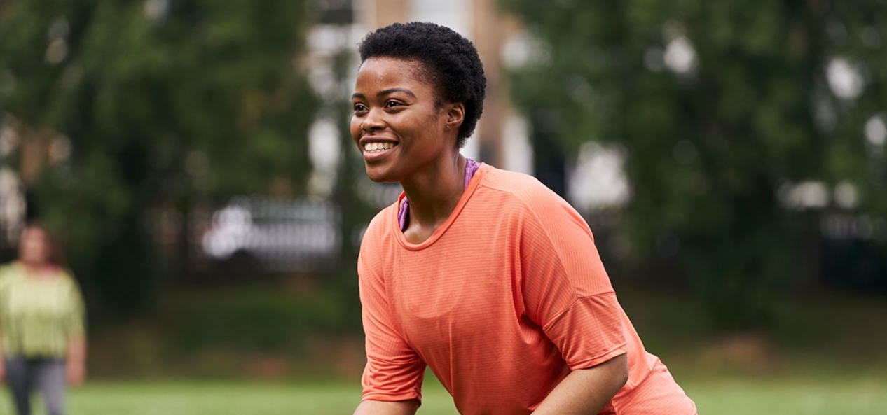 A black women enjoying playing sport in the park