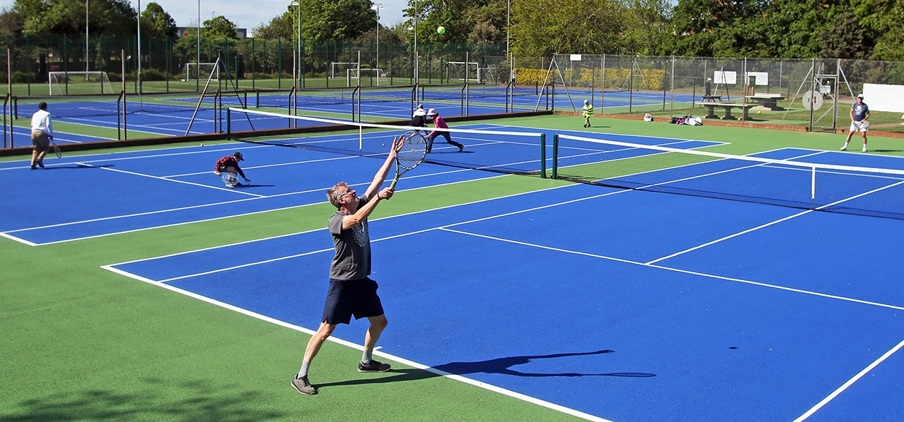 Tennis players on hard courts, after coronavirus restrictions are eased