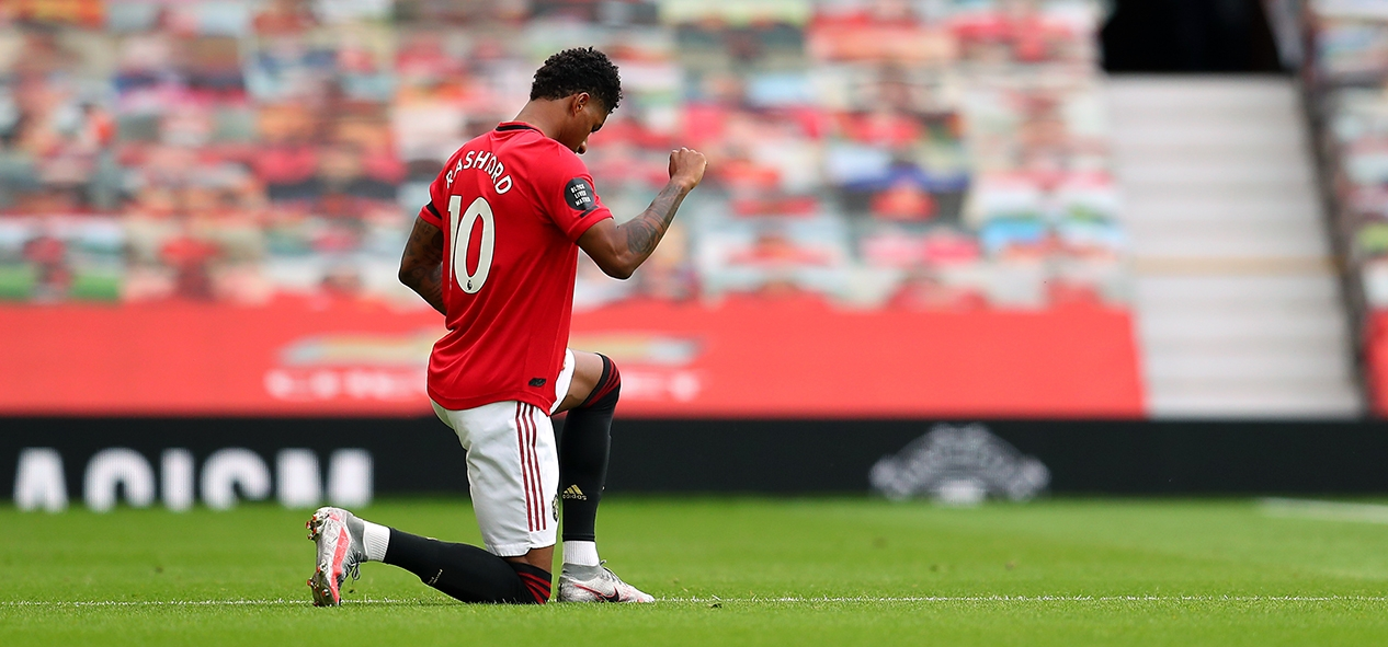 Marcus Rashford takes the knee to mark the Black Lives Matter movement during Manchester United's game with West Ham