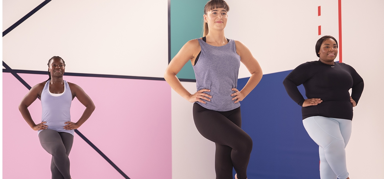 An instructor leads a workout in a studio for the Studio You exercise videos.