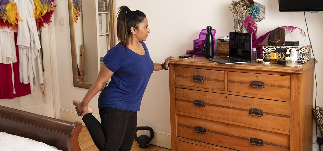 A woman working out in her bedroom