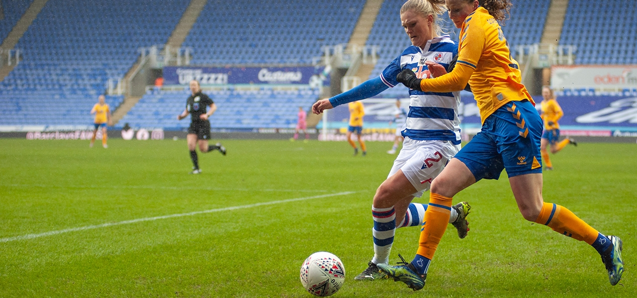 An FA Women's Super League game between Reading and Everton, played in front of empty stands.