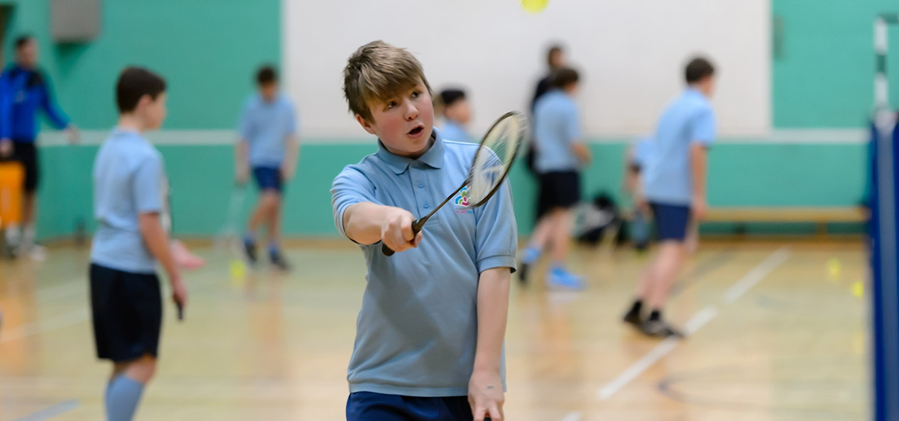 A boy plays badminton
