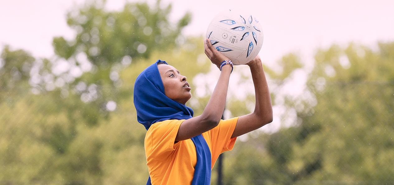 A woman playing netball