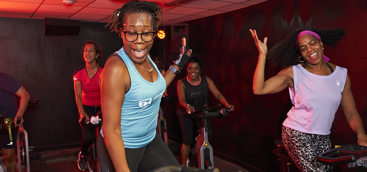 Women take part in a spinning class
