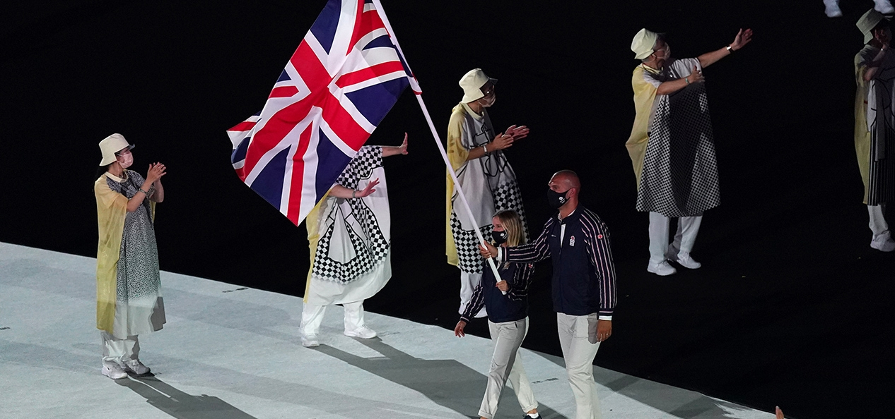 Hannah Mills and Mo Sbihi carry the Union Flag at the athletes' parade at the opening ceremony of the Tokyo 2020 Olympic Games