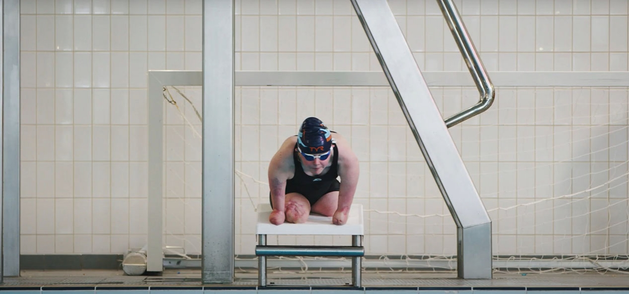 Para swimmer Ellie Challis prepares to dive into a swimming pool