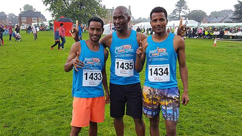 Three runners pose for a photo