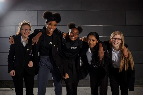A group of schoolgirls from the Football Beyond Borders Girls programme pose for a picture