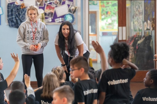 Volunteers from the Laureus Sport for Good Foundation put on a physical activity session in a Nottingham primary school hall