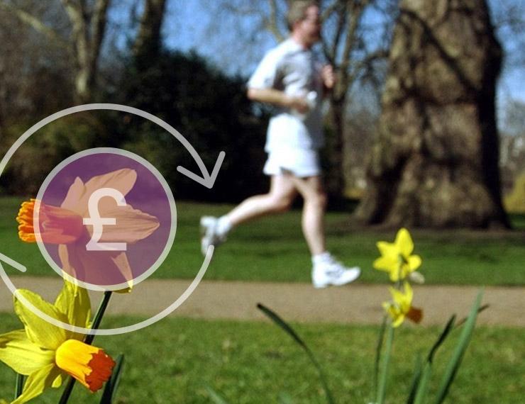 跑在公园的一个人,在顶部的一个磅标志的图形覆盖