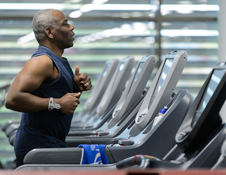 A man working out on a treadmill.
