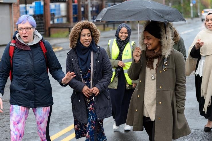 A group of women walking outside.