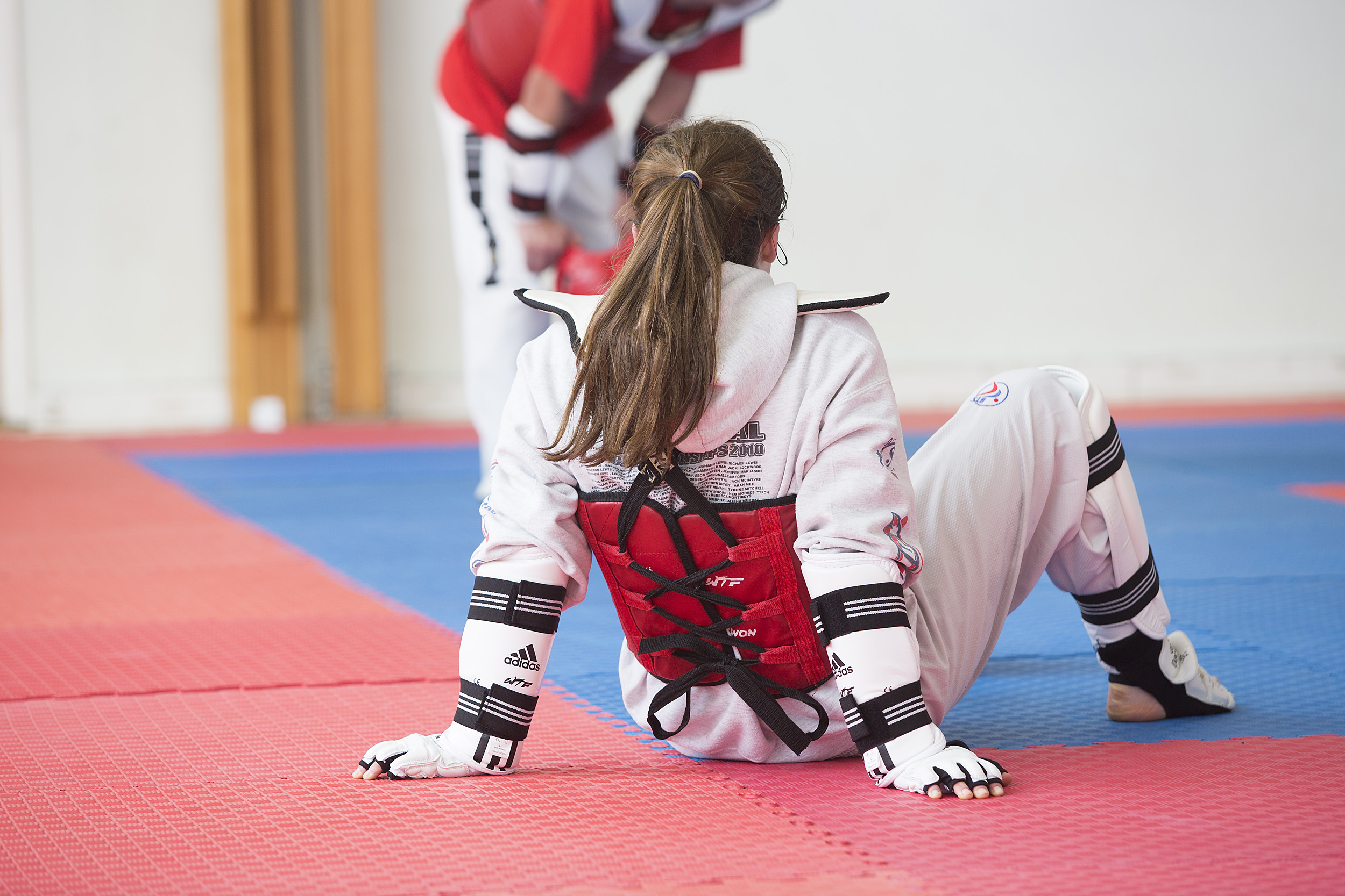girl sitting on the floor after taekwondo session