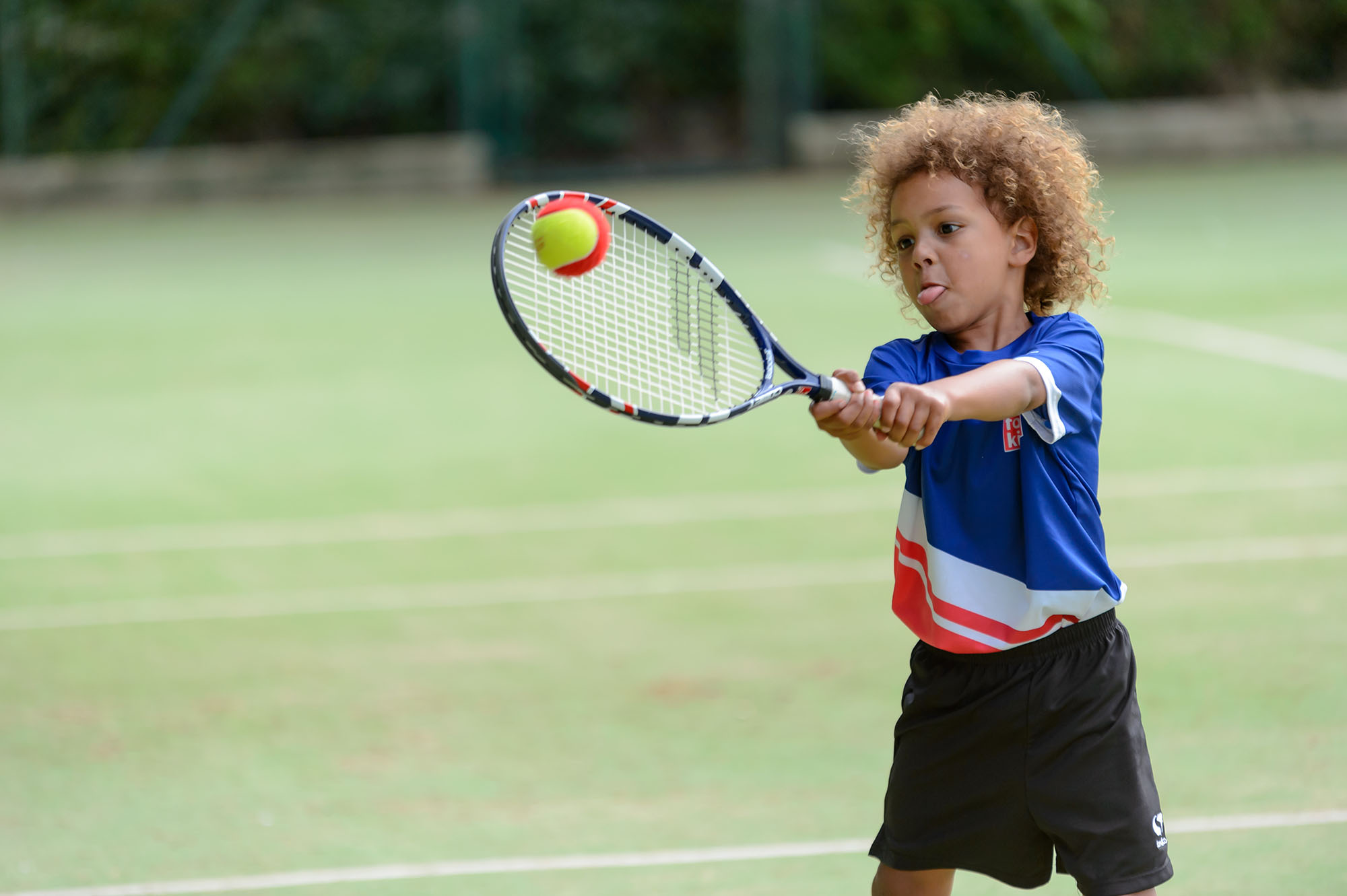 Child playing mini-tennis