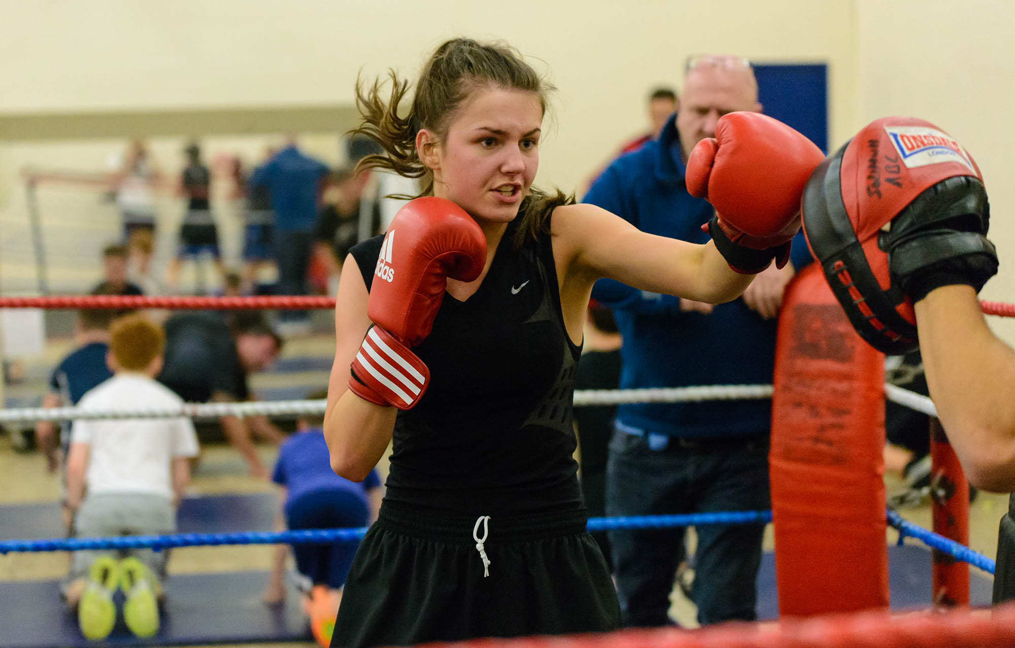 Young woman sparring in boxing ring