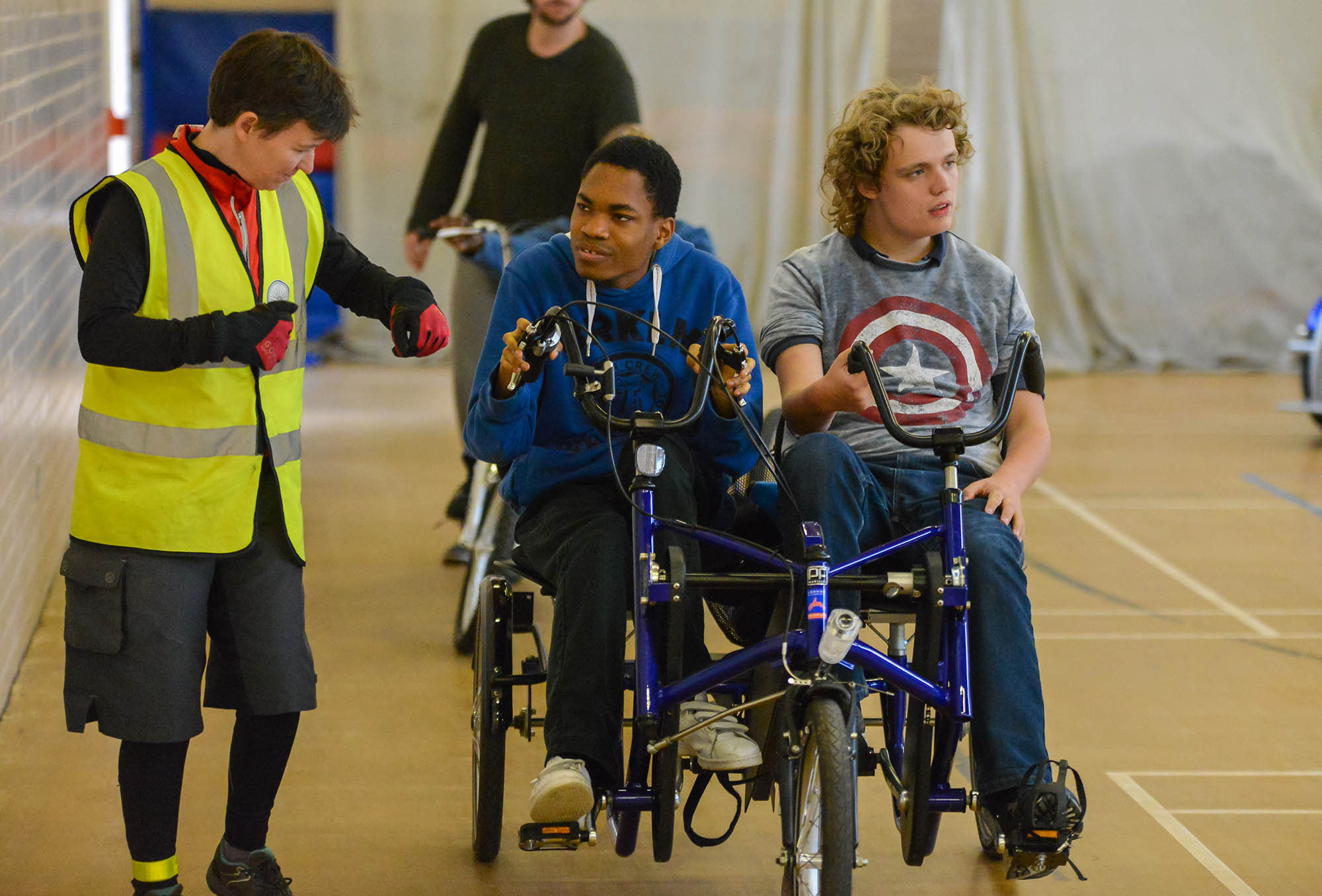 woman instructor with two boys in wheelchair